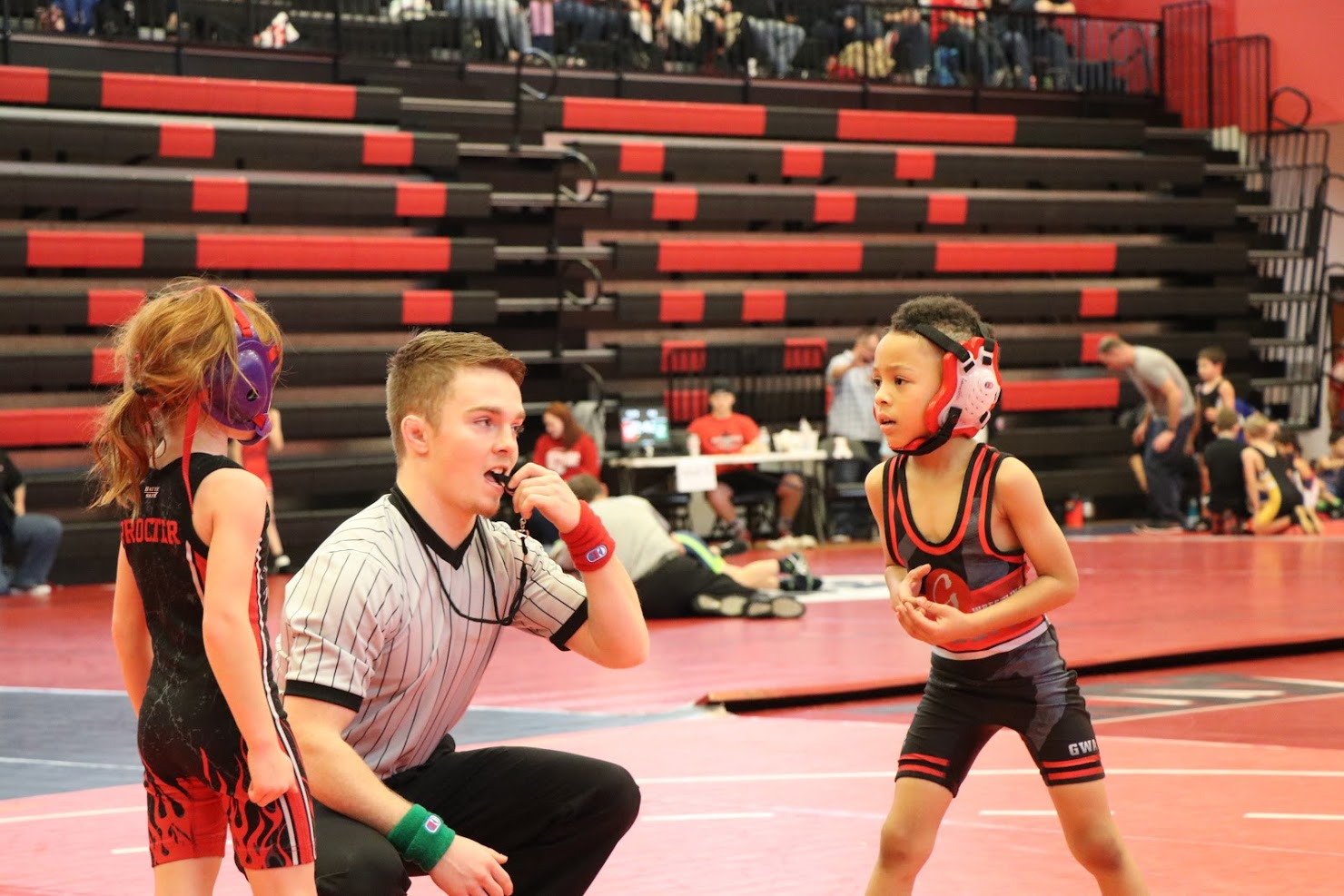 Wrestler and referee at Alexander Tournament