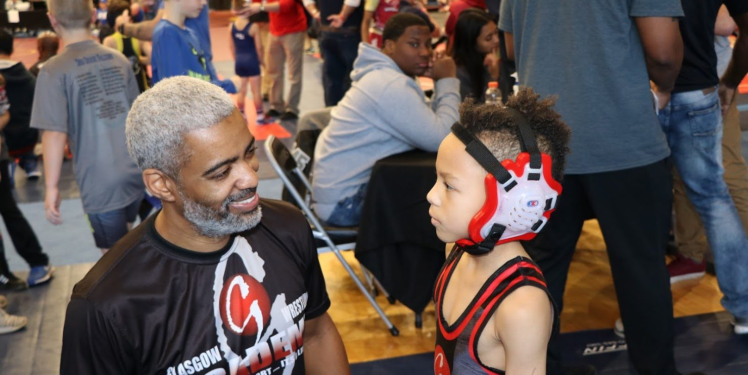 Coach G with kid